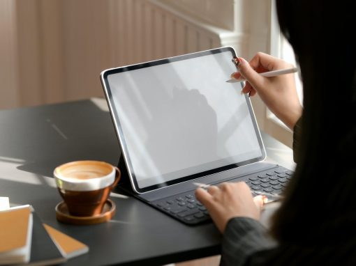 person using tablet computer with keyboard